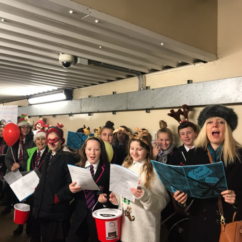 Carol Singing at Bushey Station